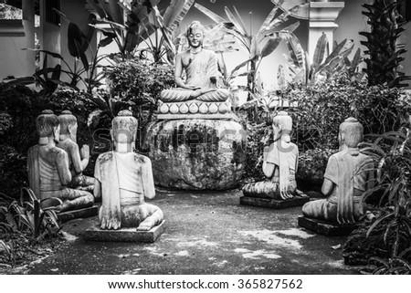 Buddha statues with five Brahmin statues - stock photo