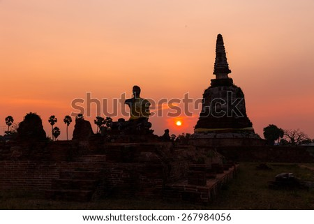 Buddha with the remains of ancient art in the ruins of. - stock photo
