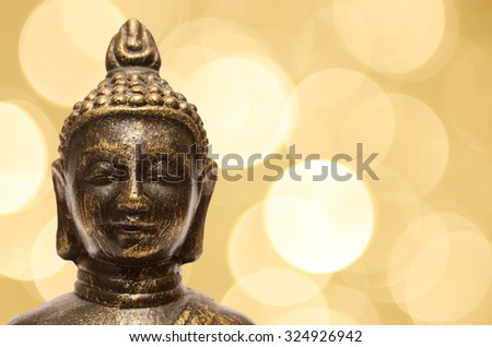 Buddha with yellow blurred lights in the background
