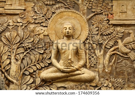 buddha wooden carving - stock photo