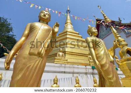 Buddhas at Wat Luang in Phrae, Thailand. - stock photo