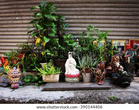 Buddhist and mythological porcelain figurine on the street of Hong Kong. - stock photo