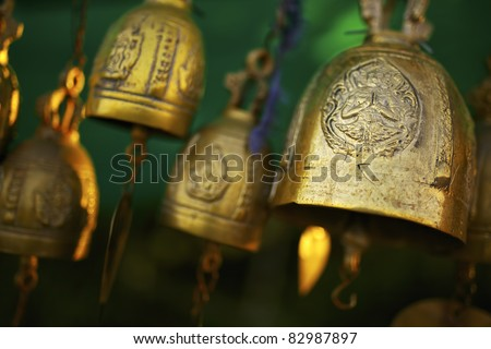 Buddhist bells inside the temple. Shallow DOF. - stock photo