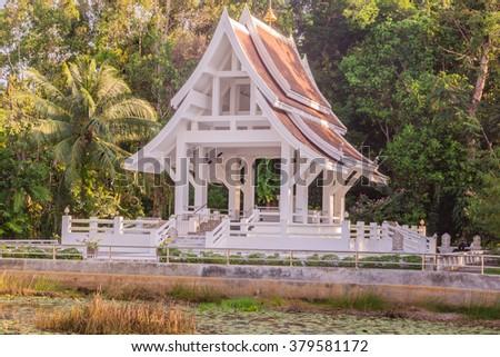 Buddhist church Thasak temple in evening, Phuket, Thailand - stock photo