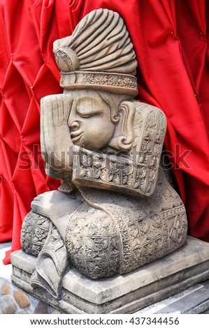 Buddhist deity of stone on the streets of Kata beach.Phuket - stock photo
