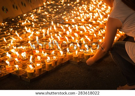 Buddhist drop down candles flame  for meditation at night, Visakabhuja Day - stock photo