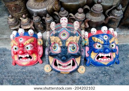 Buddhist festival masks at a shop window in Kathmandu Nepal - stock photo