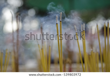 Buddhist incense smoke in a temple