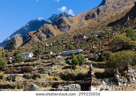 Buddhist monastery buildings on mountain slope, Phortse village stupas,  Everest Base Camp trail route, Nepal trekking, Himalaya ridge tourism. - stock photo