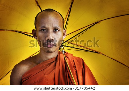 Buddhist monk holding umbrella Ceremony Concept - stock photo