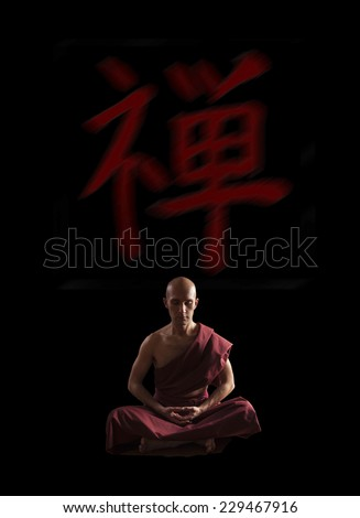buddhist monk in meditation pose  with zen symbol on the background - stock photo