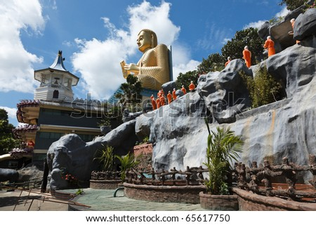Buddhist monk statues going to Gold Buddha temple, Dambulla, Sri Lanka - stock photo