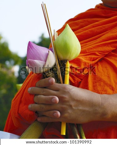 Buddhist monks be receive food in the morning at Chiangmai, Thailand. - stock photo