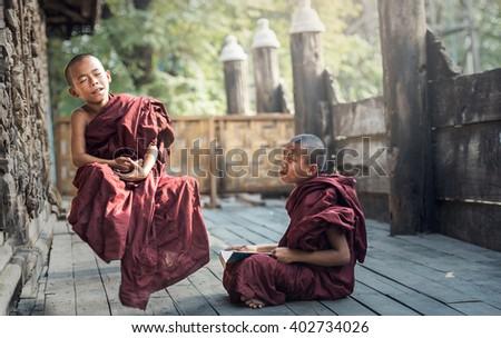 Buddhist novice in temple, Myanmar - stock photo