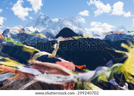 Buddhist prayer flags, Gokyo Ri mountain summit peak, snow mountains peaks. Everest Base Camp trail route, trekking Nepal culture, Himalaya ridge traveling. - stock photo