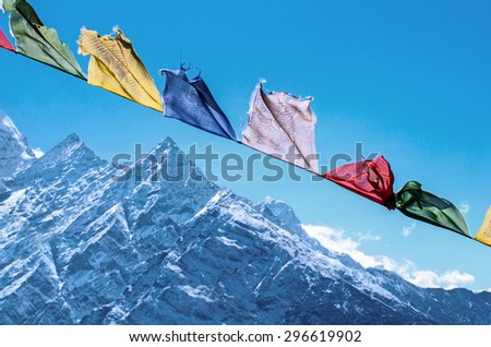 Buddhist prayer flags in the Himalaya mountains, in Nepal - stock photo