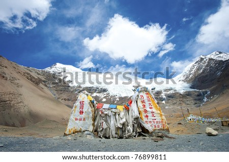 Buddhist prayer flags with snow mountain background