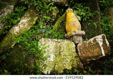 Buddhist prayer stones with written mantra - stock photo