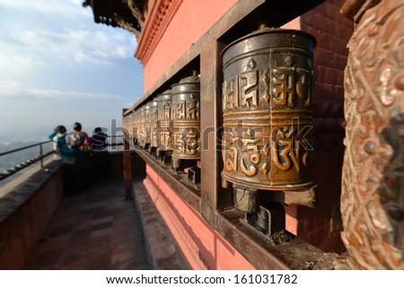 Buddhist prayer wheels in Swayambhunath, Nepal - stock photo