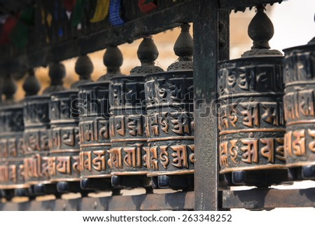 Buddhist prayer wheels, Kathmandu, Nepal. - stock photo