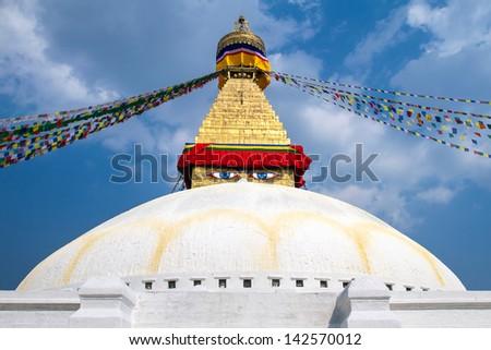 Buddhist shrine Boudhanath Stupa with Buddha wisdom eyes and praying flags in Kathmandu, Nepal - stock photo