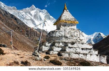 buddhist stupa with mount Lhotse - way to everest base camp - stock photo