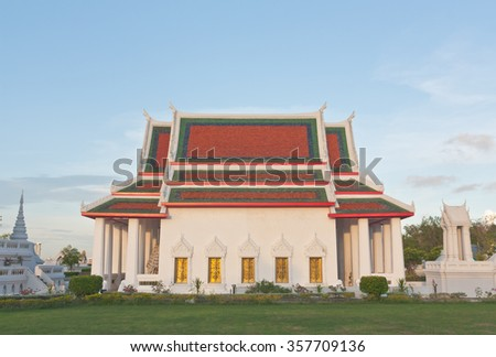Buddhist temple church under blue sky - stock photo