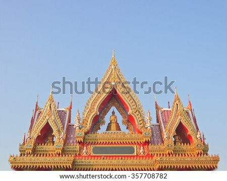Buddhist temple gate gables with buddha statue and apex - stock photo