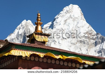 Buddhist Temple - pangboche monastery - detail of roof with mount Ama Dablam - Nepal - stock photo