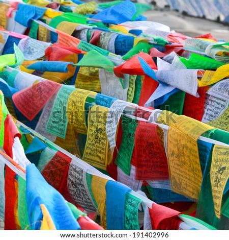 Buddhist tibetan prayer flags flying for background
