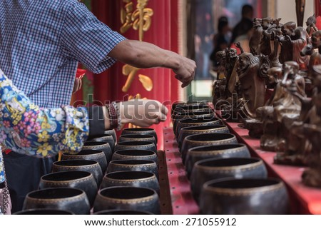 Buddhists are donating money to a Chinese temple by their faith and to maintain the temple. - stock photo