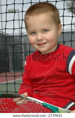 Budding tennis star - stock photo