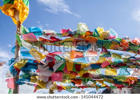 buddish flag in deqencity of china - stock photo