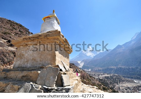 Buddist Monument in the background of summit of Ama Dablam - Himalaya, Nepal. - stock photo