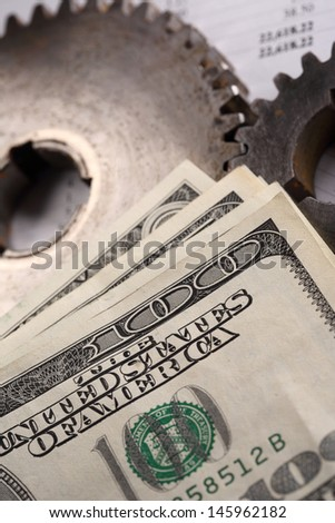 Budget, dollars and two mechanical ratchets - stock photo