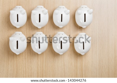 Budget planning and allocating money in different departments (piggy banks) - stock photo
