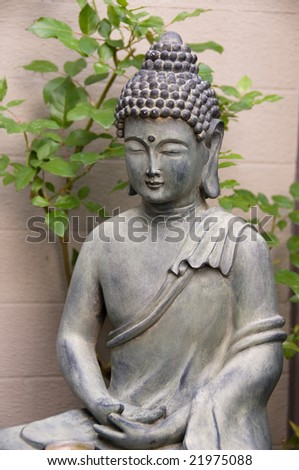 Budha statue in a mditative posture - stock photo