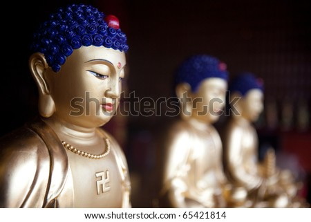 Budhhist statues in the temple of a thousand buddhas in Hong Kong - stock photo