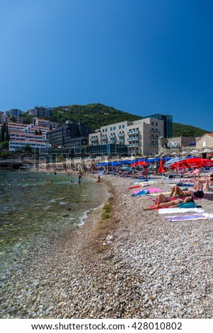 Budva, Montenegro - July 13th 2014 - Big group of people enjoying the hot summer in the beaches of Budva in Montenegro, Europe.