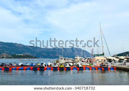 BUDVA, MONTENEGRO - SEPTEMBER 15, 2015: Unidentified people walk on the pier on the waterfront of the popular resort of Budva, Montenegro
