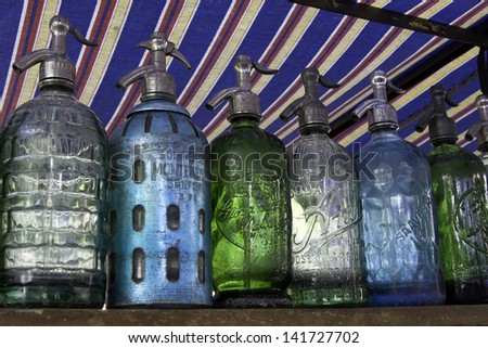 BUENOS AIRES - APRIL 22, 2012. San Telmo flee market, one of the most famous tourist place in Buenos Aires. Vintage bottles for sale on April 22, 2012 in Buenos Aires - stock photo