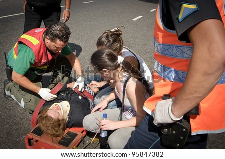 BUENOS AIRES, ARGENTINA - FEB 22: An injured woman is attended by medical personnel after a train crashed at Once train station in Buenos Aires on February 22, 2012.