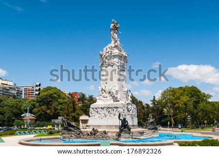 BUENOS AIRES, ARGENTINA - FEB 15, 2014: Statue of the Avenida del Libertador (Liberator Avenue) which is one of the principal thoroughfares in Buenos Aires, Argentina. It extends 25 km to north