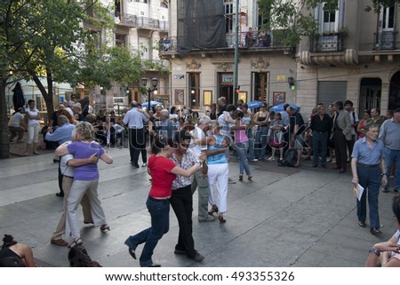 BUENOS AIRES, ARGENTINA - February 20, 2009: People dance on the plaza in Buenos Aires in afternoon.