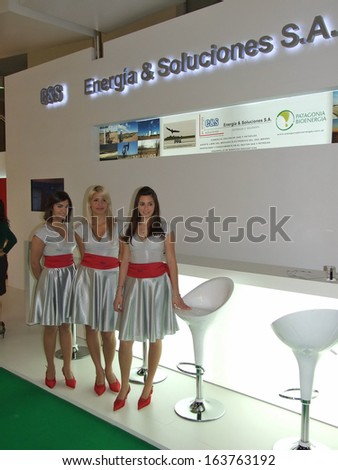 BUENOS AIRES, ARGENTINA - 5-9 OCTOBER 2009: Unknown women work on the stand of company �Energia and soluciones S.A.� on the 24th World Gas Conference on October 5-9, 2009 in Buenos Aires, Argentina.  - stock photo