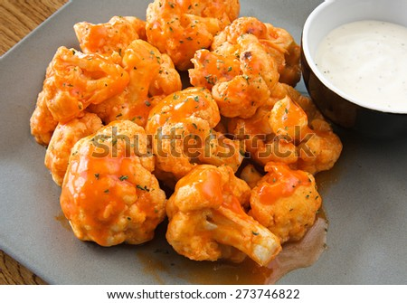 buffalo cauliflower with ranch dipping sauce close-up - stock photo