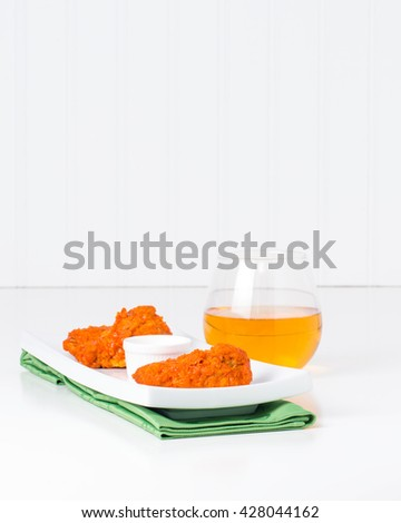Buffalo chicken wings on a more elegant place setting. - stock photo