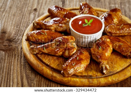 Buffalo Chicken Wings with barbecue sauce  - stock photo