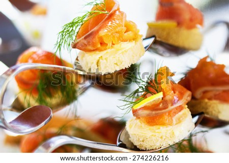 Buffed food closeup of fruits, vegetables, meat and fish arranged on banquet table. Appetizers close up. - stock photo