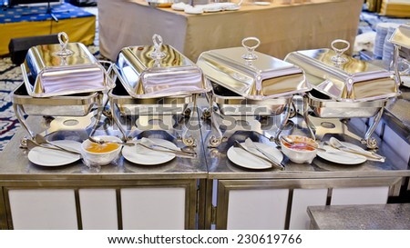 Buffet heated trays ready for service - stock photo